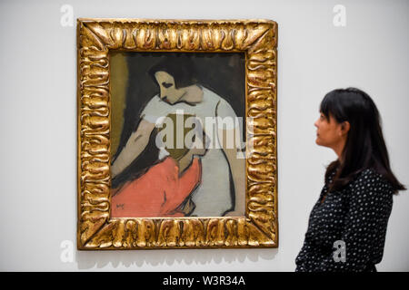 London, UK.  17 July 2019.  A staff member views 'Alarm', 1935, by Helene Schjerfbeck at the preview of the first solo UK exhibition of Finnish artist Helene Schjerfbeck at the Royal Academy of Arts in Piccadilly.  The exhibition features around 65 portraits, landscapes and still lifes and runs 20 July to 27 October 2019. Credit: Stephen Chung / Alamy Live News - Stock Photo