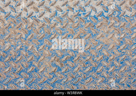 Industrial wallpaper of functional anti-slip metal diamond plate and rough raised surface pattern. Creative background macro of construction. - Stock Photo