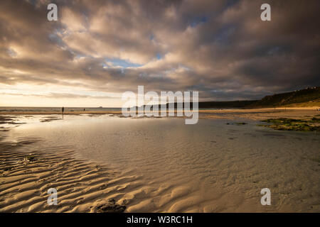 Dusk on the Beach at Sennen Cove in Cornwall, England UK - Stock Photo