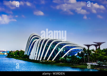 Singapore - Mar 15 , 2019: Gardens by the bay at Marine Bay with Flower Dome,  Cloud Forest, Supertree Grove and Marina Barrage in view, Singapore.