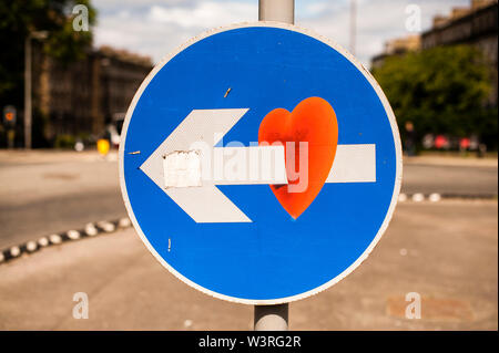 Street signs artistically modified by Clet Abraham in Edinburgh. Edinburgh, Scotland. - Stock Photo