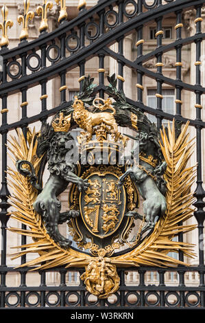 London, UK - July 8th 2014: Vertical close-up view of golden Buckingham Palace gates. Artwork  done by Bromsgrove Guild of Applied Arts - Stock Photo