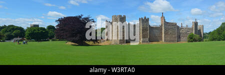 Framlingham castle and church with visitors. - Stock Photo