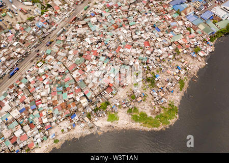 Slums in Manila, a top view. Sea pollution by household waste. Plastic trash on the beach. - Stock Photo