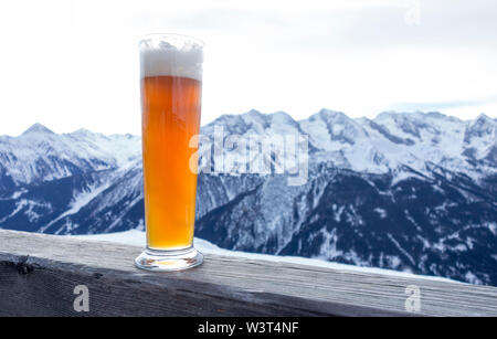 Weizener Beer in the mountains - Stock Photo