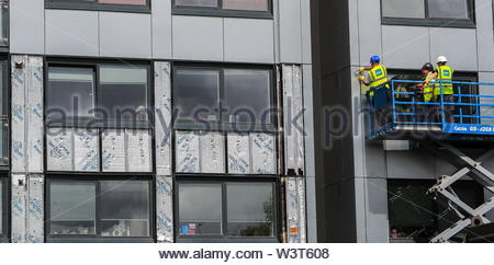 Embargoed to 0001 Thursday July 18 File photo dated 26/06/17 of cladding is removed from a building. A report has said the Government is 'still not doing enough' to remove dangerous cladding from buildings more than two years on from the Grenfell Tower tragedy. - Stock Photo