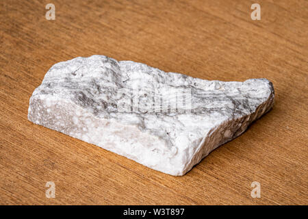 Grey and white anhydrite mineral precious stone - Stock Photo