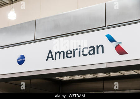 Athens, Greece. Logo of American Airlines, a major American airline headquartered in Fort Worth, Texas. at Athens International Airport - Stock Photo