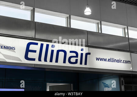 Athens, Greece. Logo of Ellinair, a Greek airline headquartered in Thessaloniki, at Athens International Airport - Stock Photo