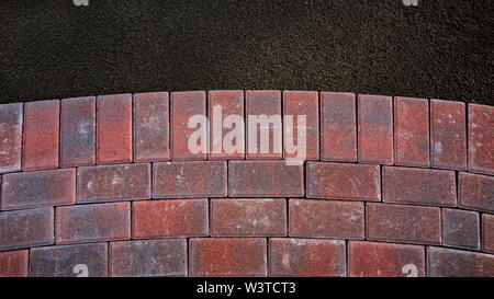 Curved brick walkway under construction with paving bricks (Pavers) on aggregate base - Stock Photo