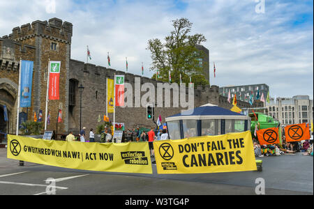 CARDIFF, WALES - JULY 2019: Large bilingual banner blocking Castle Street in Cardiff city centre. The road was blocked by Extinction Rebellion - Stock Photo