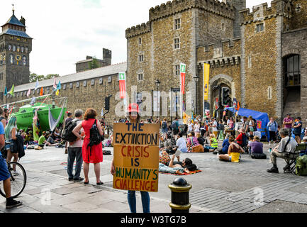 CARDIFF, WALES - JULY 2019: Person holding a notice with a message outside Cardiff Castle at the Climate Emergency protest by Extinction Rebellion - Stock Photo