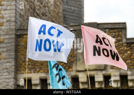 CARDIFF, WALES - JULY 2019: Close up of 'Act Now' flags in Cardiff city centre at a Climate Emergency protest by Extinction Rebellion. - Stock Photo