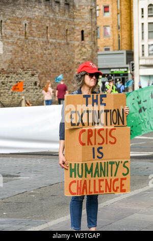CARDIFF, WALES - JULY 2019: Person holding a notice with a message at the Climate Emergency protest by Extinction Rebellion in Cardiff city centre. - Stock Photo