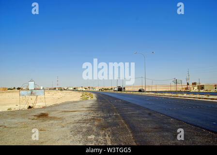 A section of the Kings Highway follows the ancient trading route between Amman and Petra in Jordan - Stock Photo