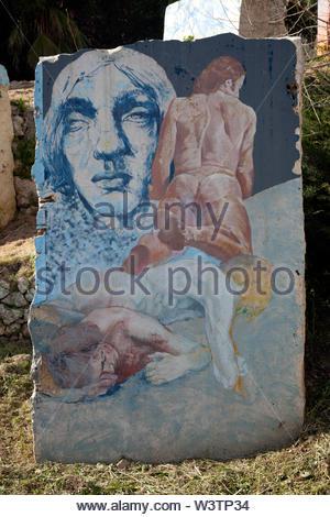 Painted stone representing scene of Dante's Divine Comedy - Stock Photo