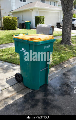 large recycling bin left kerbside for weekly collection in florida USA United States of America - Stock Photo