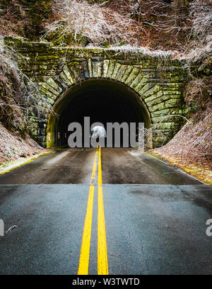Entrance to the Little Switzerland tunnel on the Blue Ridge Parkway, North Carolina, USA, following an ice-storm. An ice storm is a type of winter sto - Stock Photo