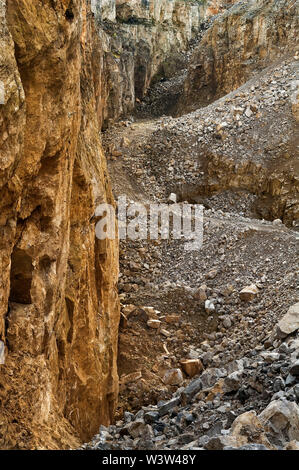 Quarry workings for Fluorite in the Peak District showing a roadway through the working faces - Stock Photo