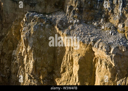 Quarry workings for Fluorite in the Peak District in bright sunshine showing the working faces - Stock Photo