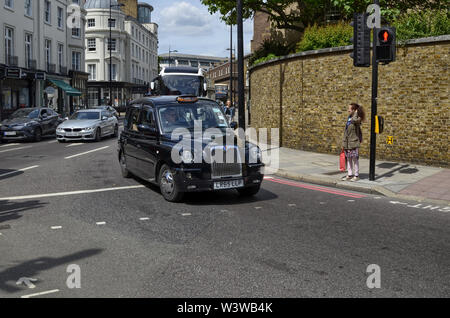 London, United Kingdom, June 2018. London taxis, called cabs, are one of the symbols of the city. Classically of strictly black color. Sometimes with - Stock Photo