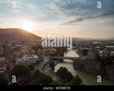 Aerial Cityscape of Tbilisi, Georgia, sunset and cityscape of Tbilisi, Georgia, view on the mountains on backround. - Stock Photo