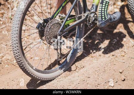 Close up detail of rear wheel of mountain bike - Stock Photo