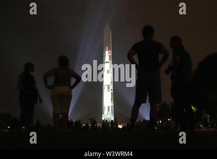 Beijing, USA. 16th July, 2019. An image of a Saturn V rocket, which was used during Apollo 11 moon landing mission, is projected on the Washington Monument in Washington, DC, the United States, July 16, 2019. The projection is to celebrate the 50th anniversary of the Apollo 11 moon landing. Credit: Liu Jie/Xinhua/Alamy Live News - Stock Photo