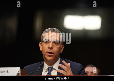 Beijing, USA. 16th July, 2019. David Marcus, head of Facebook's blockchain subsidiary Calibra, testifies before the Senate Banking, Housing and Urban Affairs Committee on 'Examining Facebook's Proposed Digital Currency and Data Privacy Considerations' on Capitol Hill in Washington, DC, the United States, on July 16, 2019. U.S. senators on the Senate Banking Committee used the stage of a hearing Tuesday to grill Facebook executive David Marcus on the controversial Libra cryptocurrency the social network giant plans to unveil next year. Credit: Liu Jie/Xinhua/Alamy Live News - Stock Photo