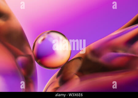 Small glass ball in abstract macro composition. - Stock Photo
