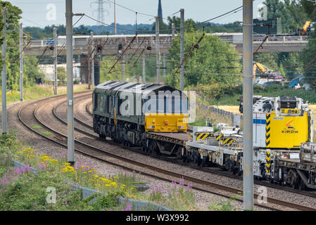 Double headed Class 66 locomotives. A type of six-axle diesel electric freight locomotive pictured on the West Coast Main line at Winwick hauling Kiro - Stock Photo