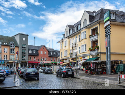 Kranoldplatz street view of apartment building & shops In Lichterfelde-Berlin,Germany - Stock Photo