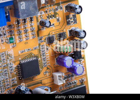 Detailed complicated computer circuitry, circuit board with electronic elements attached isolated on white background. Advanced technology hardware - Stock Photo
