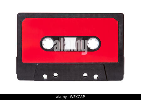 Blank red vintage cassette tape with an empty label isolated on white background, old retro audio equipment concept - Stock Photo