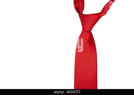 A classic red tie isolated on white background. Formal men clothes, suit elements and general red color concept, nobody - Stock Photo