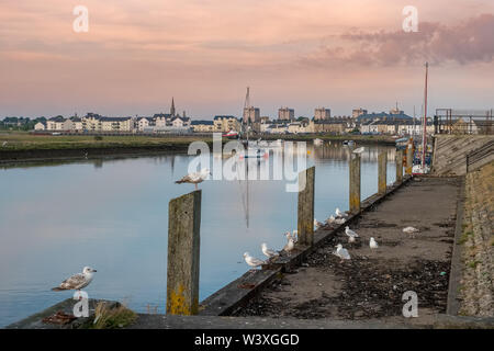 Irvine Harbour North Ayrshire Scotland on a calm summers evening with reflections seagulls and boats with the Irvine Town Spires in the distance. - Stock Photo