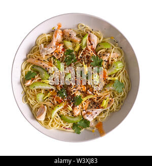 Udon with Chicken and Peanut Garlic Sauce with sesame in a white bowl isolated on white background. - Stock Photo