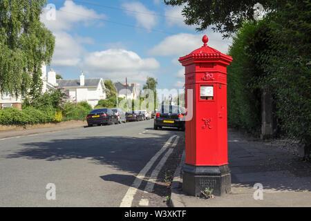 One of Cheltenham's rare original hexagonal shaped Royal Mail Penfold post boxes - Stock Photo