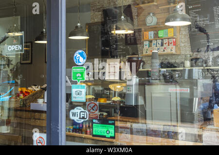 Looking into a trendy coffee shop through the window - Stock Photo