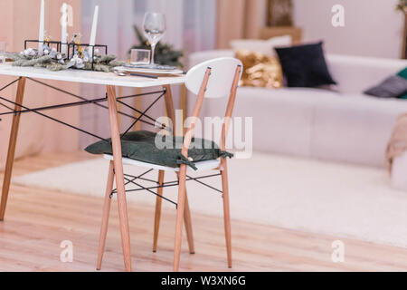 Table setting in the New Year's style. Simple and stylish interior rooms in the New Year's style - Stock Photo