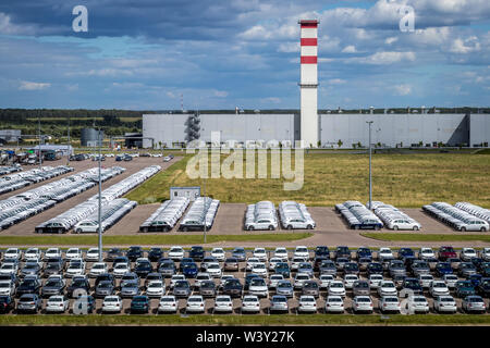 Volkswagen, Russia, Kaluga  - JULY 4, 2019: New cars parked in a distribution center on a sunny day in the summer, a car factory. Parking in the open - Stock Photo