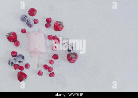 homemade berry ice cream on marble background - Stock Photo
