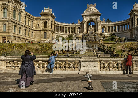 Marseilles, France, March 2019, tourist being photographed by the Palais Longchamp. house of the 'Musée des beaux-arts - Stock Photo