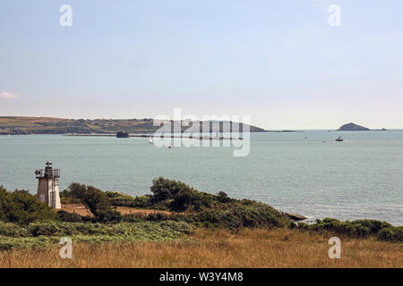 The Breakwater, Plymouth Sound and the Mewstone as seen from the path when approaching from Mount Edgcumbe Park - Stock Photo