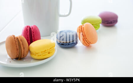 Macarons and esresso coffee on white table, blur background, close up view with details - Stock Photo