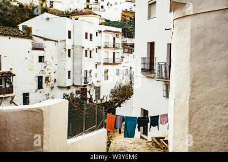 View down a narrow street with washing - Stock Photo