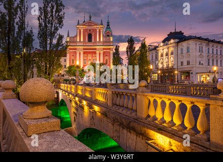The Pink Franciscan Church and the triple bridge Tromostovje at night  Ljubljana Slovenia EU Europe - Stock Photo