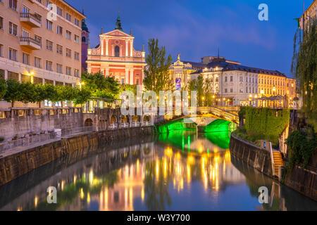 The Pink Franciscan Church Ljubljanica river and the triple bridge at night  ljubljana Slovenia EU Europe - Stock Photo