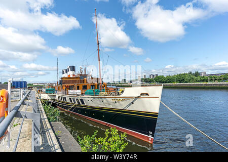 Ocean going paddle steamer P. S. Waverley lying tied up beside the Glasgow Science Centre Pacific Quay by the River Clyde in Glasgow Scotland UK - Stock Photo