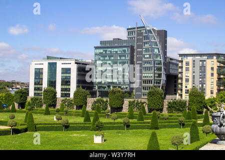 The formal gardens of The Royal Hospital, Kilmainhan, Dublin, Ireland and in the background the Heuston Quarter office, apartment and retail complex. - Stock Photo